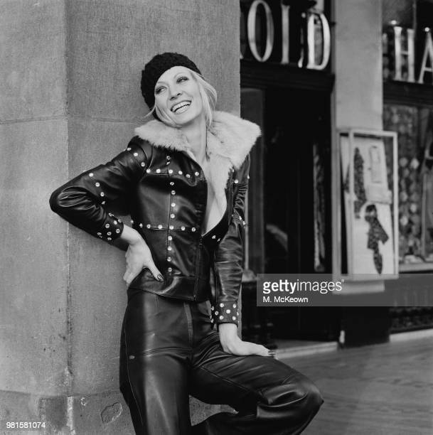 English model and actress Vicki Hodge wears a studded fur lined rocker jacket with matching black leather trousers in London on 11th April 1972