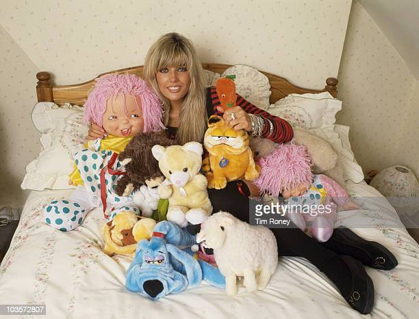 English model and pop singer Mandy Smith with a collection of stuffed toys circa 1986