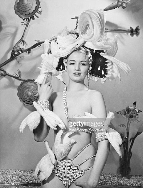 English model and showgirl Christine Keeler in a stage outfit circa 1962 Keeler's affair with British Secretary of State for War John Profumo caused...