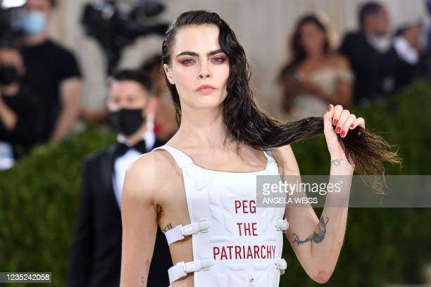 English model Cara Delevingne arrives for the 2021 Met Gala at the Metropolitan Museum of Art on September 13, 2021 in New York. - This year's Met...