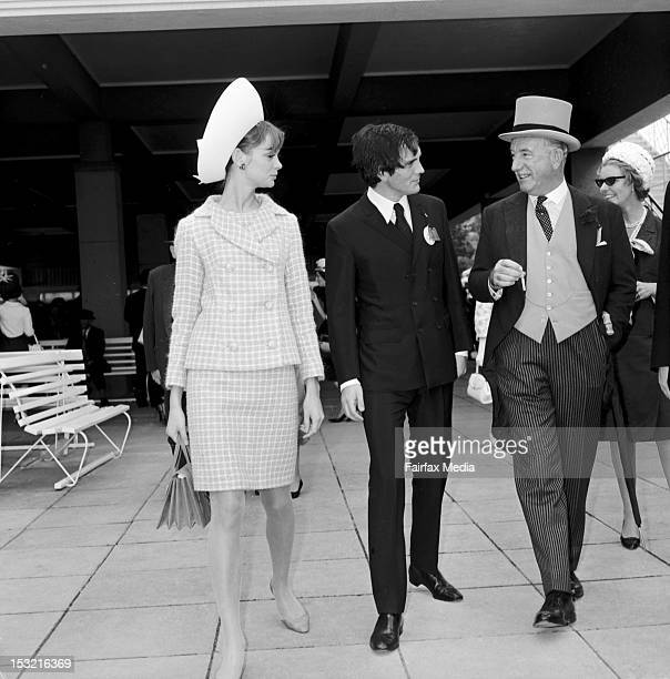 English model Jean Shrimpton at her companion Terence Stamp at Flemington races on Melbourne Cup day, November 2 1965. Shrimpton wore a three-piece...