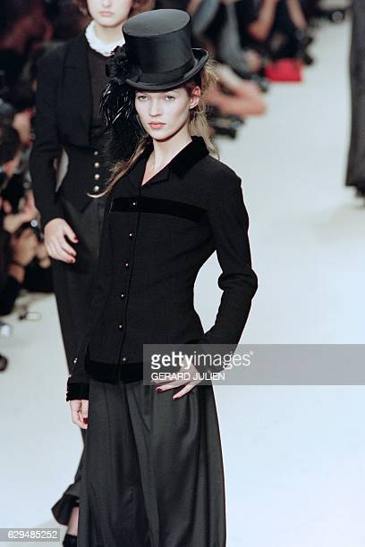 English model Kate Moss displays a black jacket designed by Karl Lagerfeld for the FallWinter readytowear collection of Chanel on March 10 1994 in...