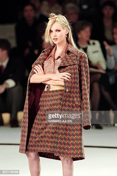 English model Kate Moss displays a creation by Karl Lagerfeld for Chanel as part of his 1996 fallWinter readytowear collection on March 18 1996 in...