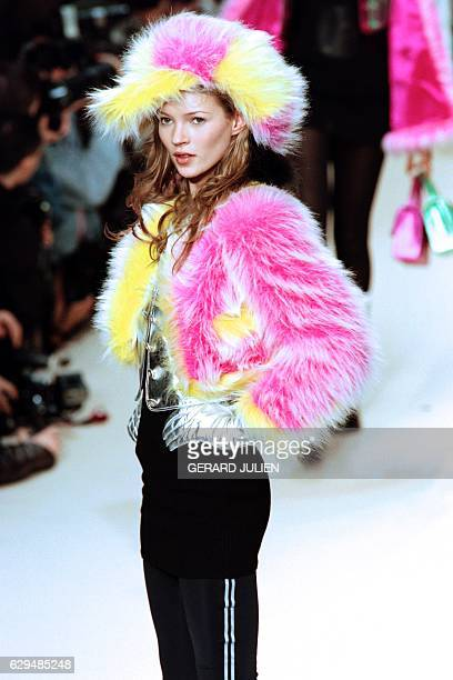 English model Kate Moss displays a creation designed by Karl Lagerfeld for the FallWinter readytowear collection of Chanel on March 10 1994 in Paris...