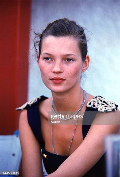 English model Kate Moss photographed backstage at fashion show in the early 1990's.