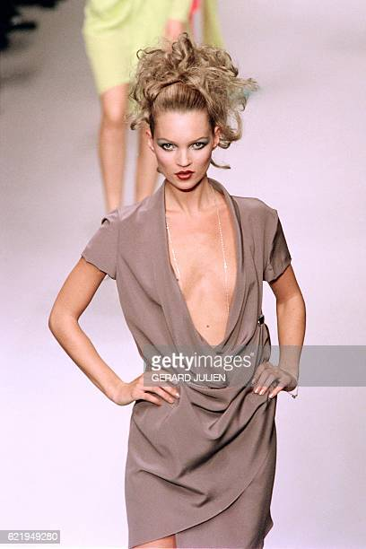 English model Kate Moss presents a creation for fashion house Karl Lagerfeld as part of the 1996 SpringSummer readytowear collection in Paris on...