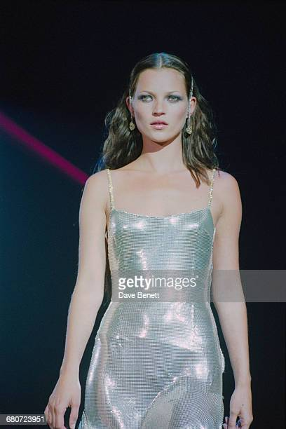 English model Kate Moss wearing a silver cocktail dress at the 'Diamonds Are Forever' fashion show hosted by De Beers and Versace at Syon House in...