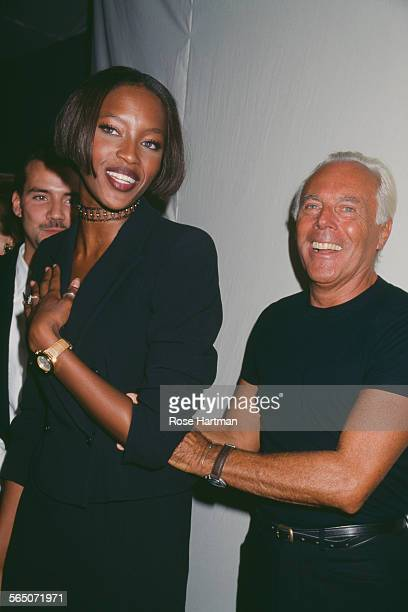 English model Naomi Campbell and Italian fashion designer Giorgio Armani at a private party circa 1996