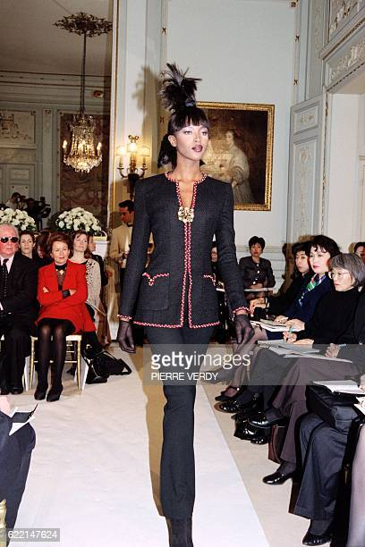 English model Naomi Campbell displays a creation by Karl Lagerfeld for Chanel as part of his SpringSummer highfashion collection on January 23 1996...