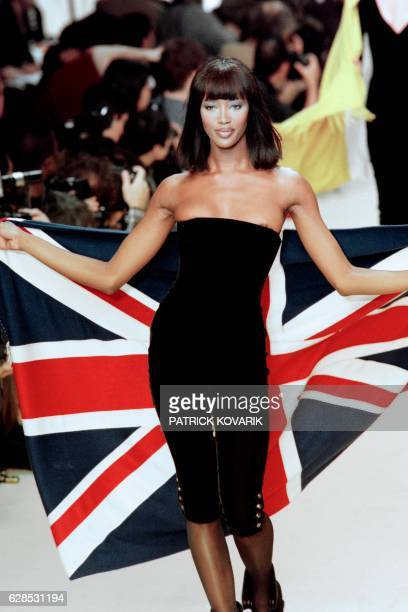 English model Naomi Campbell displays a creation by Karl Lagerfeld for Chanel as part of his FallWinter readytowear collection on March 10 1994 in...