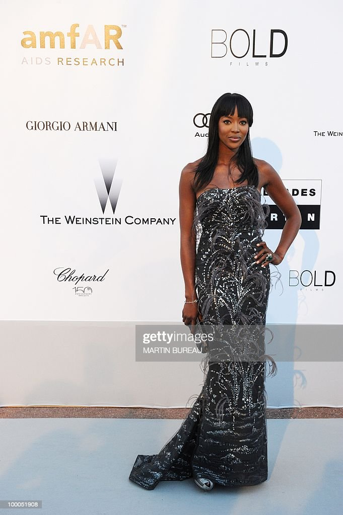 English model Naomi Campbell poses while