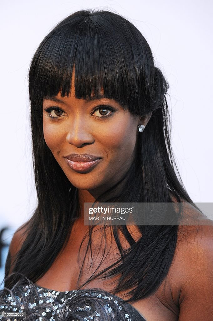 English model Naomi Campbell poses while arriving to attend the 2010 amfAR's Cinema Against Aids on May 20, 2010 in Antibes, southeastern France.