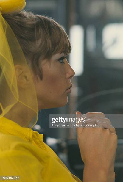 English model Pattie Boyd filming a commercial for Dop Pearlized Shampoo by L'Oreal, UK, 1966.