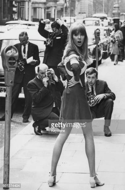 English model Pattie Boyd, the wife of George Harrison of the Beatles, returns to work in London, 22nd April 1966. She is wearing a Hoopla mini skirt...