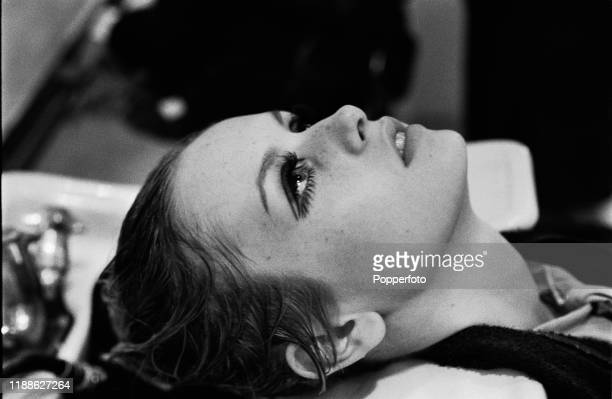 English model Twiggy has her hair washed in a sink at a hair salon in London in October 1966