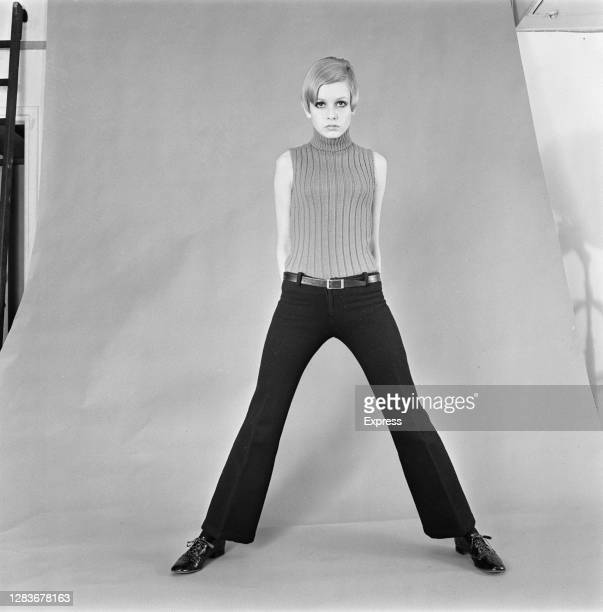 English model Twiggy in a pair of dark belted trousers, 21st February 1966.