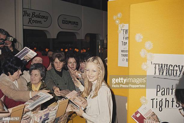 English model Twiggy pictured selling her own brand of tights in the hosiery department at Selfridges department store in Oxford street London on...
