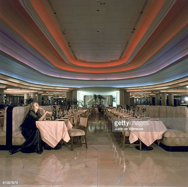 English model Twiggy sits alone in the Rainbow Room of Biba's Kensington store 1971