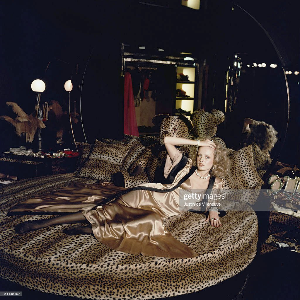 English model Twiggy stretches out on a leopardskin bed at Biba's Kensington store, 1971.