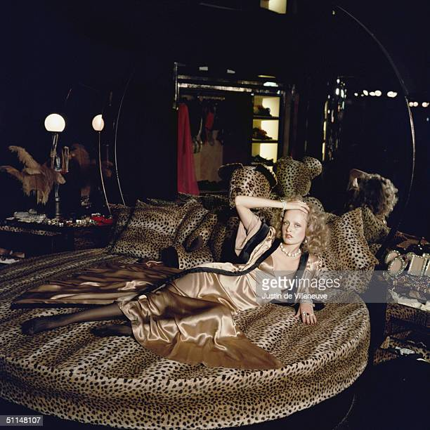 English model Twiggy stretches out on a leopardskin bed at Biba's Kensington store 1971