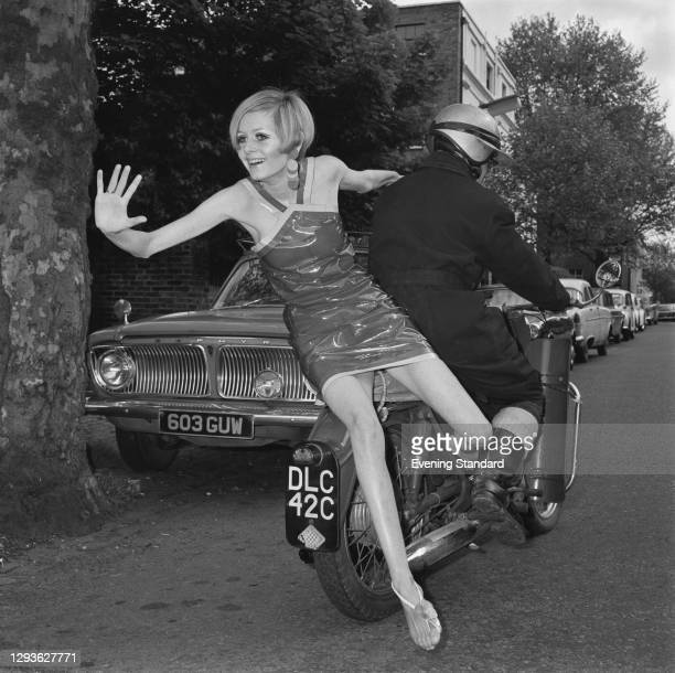 English model Twiggy wearing Bagatel autumn fashions - including this plastic disposable mini-dress, UK, 19th May 1966.