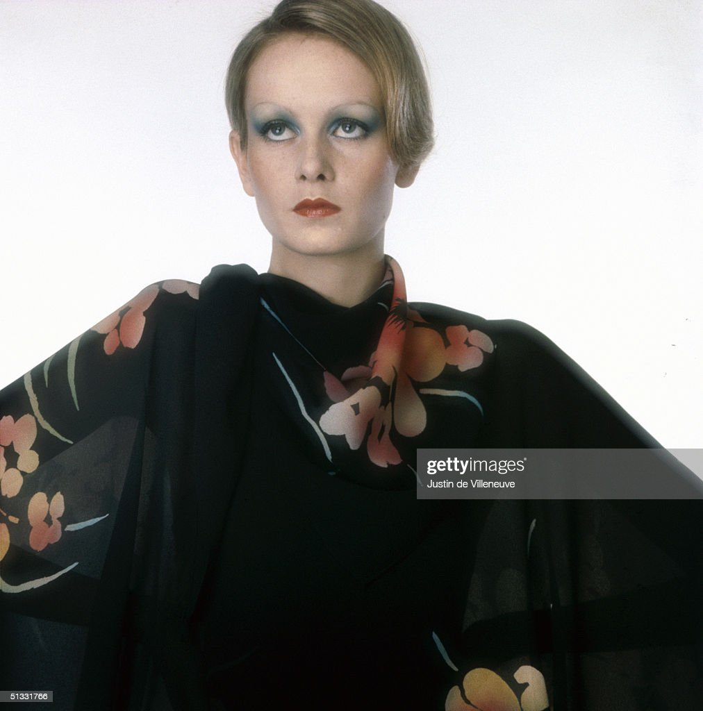 English model Twiggy wears a fine black shawl with a floral pattern, late 1960s.