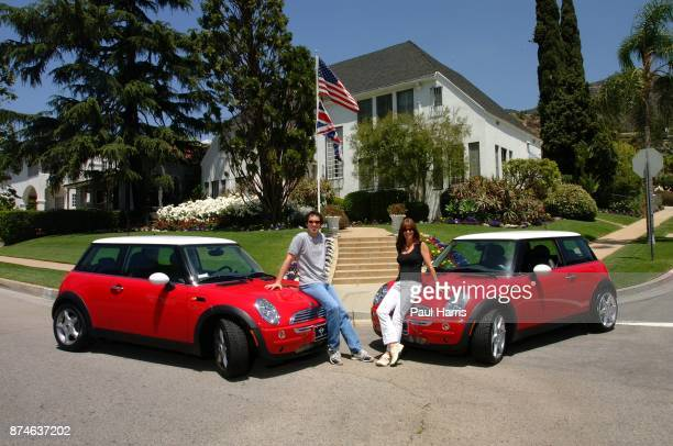 English model/actress Amanda Pays and English software engineer Marcus Edwardes with their new BMW Mini Coopers April 29 2002 in Glendale Los Angeles...
