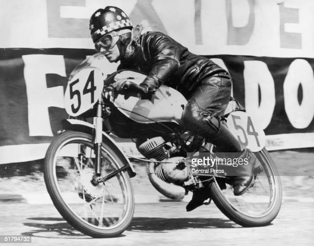 English motorcyclist Beryl Swain rounding Governer's Bridge on her 50cc motorbike during the annual T.T race in the Isle of Man, 9th June 1962. She...