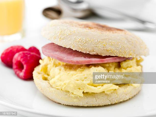 english muffin with scramble eggs and canadian bacon - canadian culture stock pictures, royalty-free photos & images