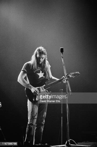 English multi-instrumentalist, singer and songwriter David Gilmour playing Fender Stratocaster guitar, using wah wah pedal, on stage at Shelter...