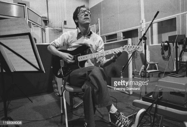 English multi-instrumentalist, vocalist and songwriter Hank Marvin of rock band The Shadows during a recording session at Abbey Road Studios, London,...