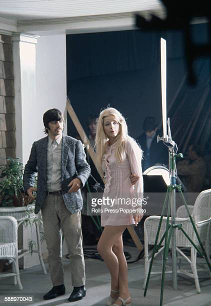 English musician actor and drummer with The Beatles Ringo Starr pictured with Swedish actress Ewa Aulin on the set of the film 'Candy' in 1968