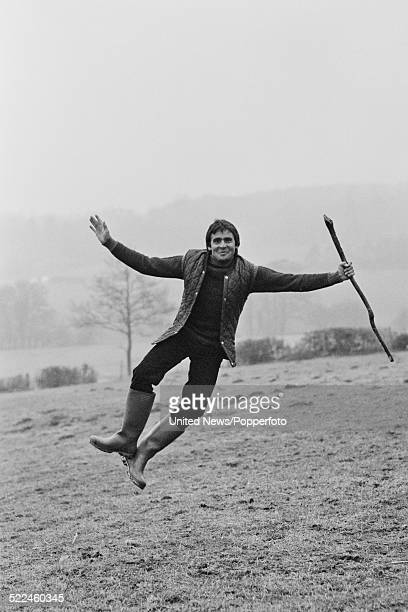 English musician actor and ex member of The Monkees Davy Jones pictured jumping in a field near his home in East Grinstead Sussex on 21st February...
