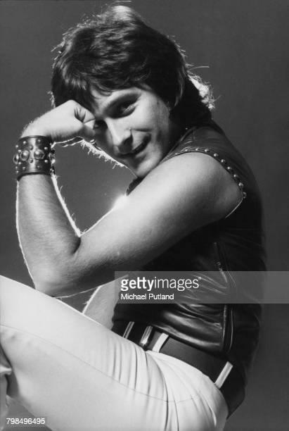 English musician and bass guitarist Ray Stiles of British glam rock group Mud posed wearing a leather waistcoat in England on 19th September 1975