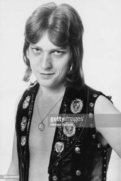 English musician and bass guitarist Steve Priest of British glam rock group The Sweet posed wearing a leather waistcoat in England in April 1975