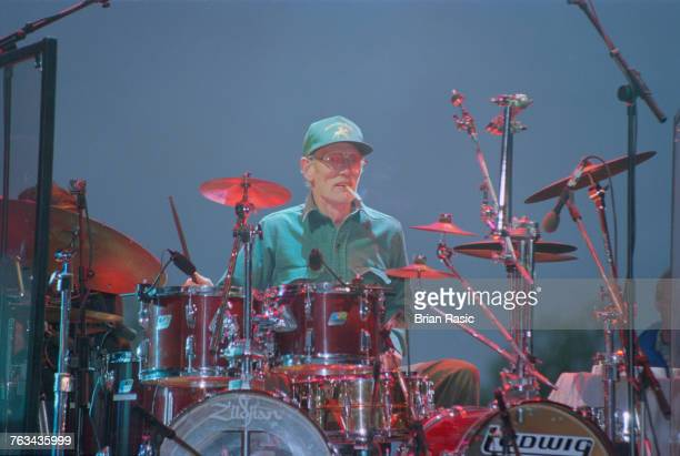 English musician and drummer Ginger Baker performs live on stage at the drum kit at Virgin Records 21st Birthday Party concert in London in June...