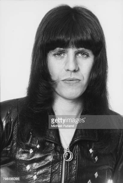 English musician and drummer Mick Tucker of British glam rock group The Sweet posed wearing a leather jacket in England in April 1975