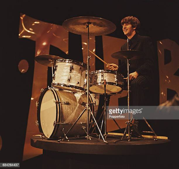 English musician and drummer with The Beatles Ringo Starr pictured at his drum kit during rehearsals the day before the band's first appearance on...