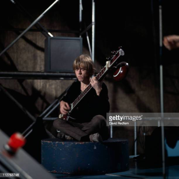 Brian Jones guitarist with The Rolling Stones playing the sitar on the set of ITV music show Ready Steady Go where the band were performing Paint It...