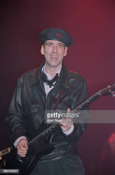 English musician and guitarist Mick Jones performs live on stage with Big Audio Dynamite at the Shepherd's Bush Empire in London in November 1994....