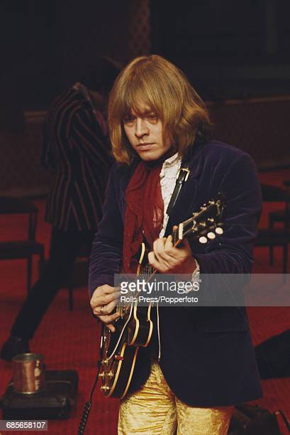 English musician and guitarist with Rolling Stones Brian Jones pictured playing his guitar during rehearsals for the Rolling Stones Rock and Roll...