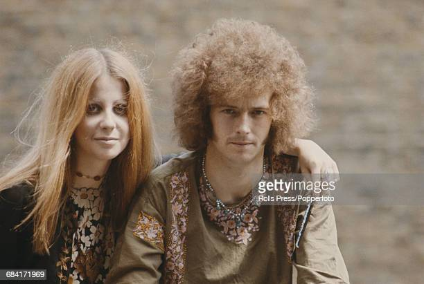 English musician and guitarist with the blues rock group Cream Eric Clapton posed with his girlfriend Charlotte Martin in London in summer 1967