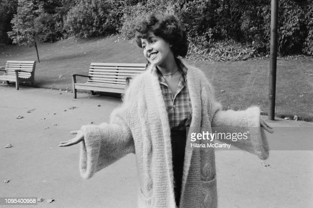 English musician and lead singer of the band X-Ray Spex, Poly Styrene in a park before attending the 'Women of the Year Lunch', London, UK, 26th...