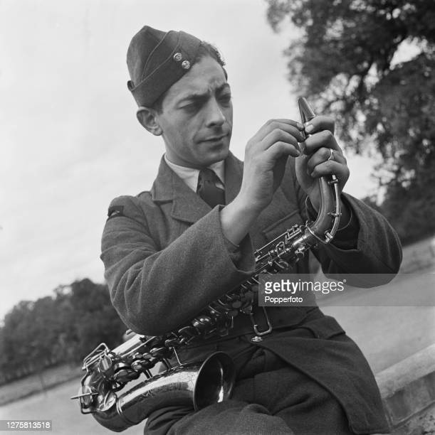 English musician and saxophonist Harry Lewis adjusts the reed of his saxophone as he prepares for an engagement with the Royal Air Force Dance...