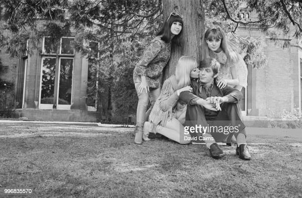 English musician and singer Georgie Fame pictured with his costars from the film 'The MiniMob' Lucille Soong Gretchen Regan and Madeline Smith in the...