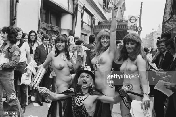 English musician and singer Screaming Lord Sutch pictured with three naked women outside Selfridges in Oxford Street in a bid to promote his upcoming...