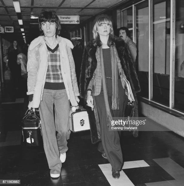 English musician and singersongwriter Bill Wyman and girlfriend Astrid Lundstrom at Heathrow airport UK 24th January 1975