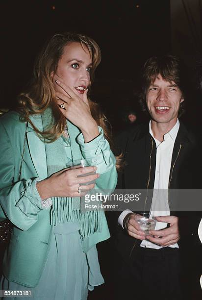 English musician and singer-songwriter Mick Jagger with his girlfriend American model and actress Jerry Hall attend an event being held at...