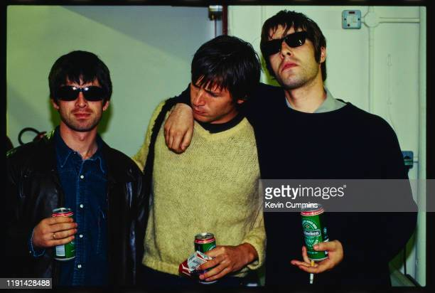 English musician and singer-songwriter Noel Gallagher and English singer Liam Gallagher of rock band Oasis with American musician Evan Dando of rock...