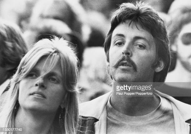 English musician and songwriter Paul McCartney and his wife Linda McCartney join over 250,000 music fans to watch the Rolling Stones headline the...